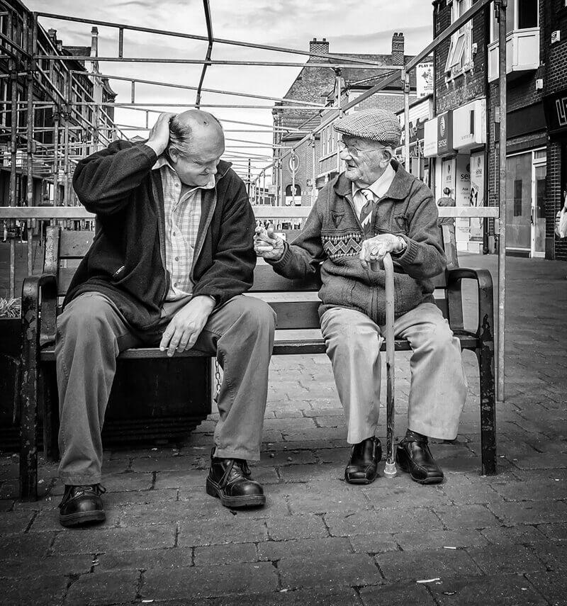 Men talking on bench, Castleford