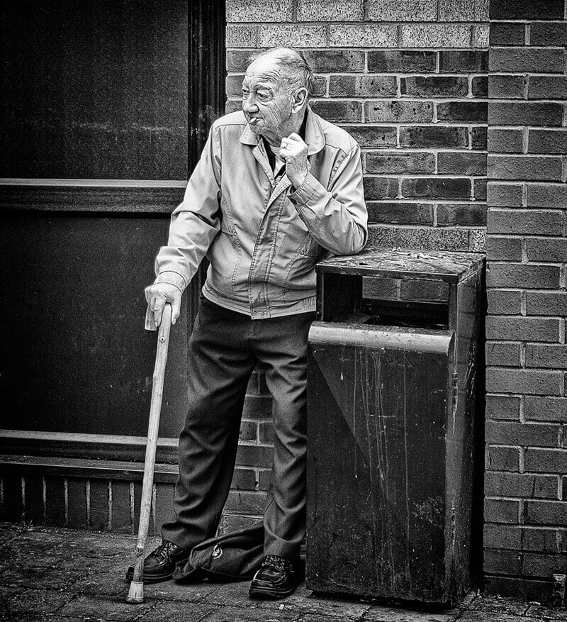 Old man smoking outside Castleford market hall
