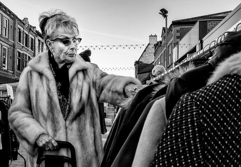 Woman in fur coat at flea market