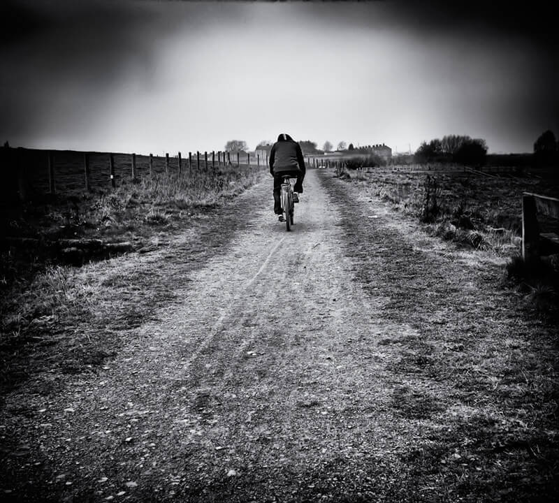 Man riding bicycle, Frytson colliery site
