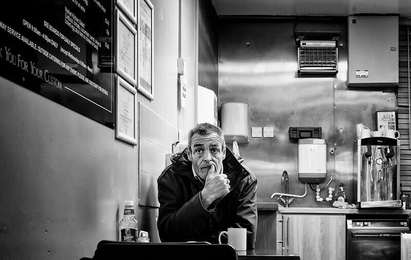 Sad looking man in market cafe, Castleford