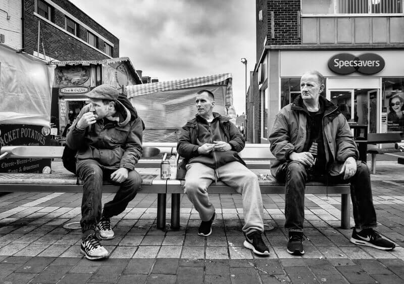 Street drinking, men on bench Castleford town centre