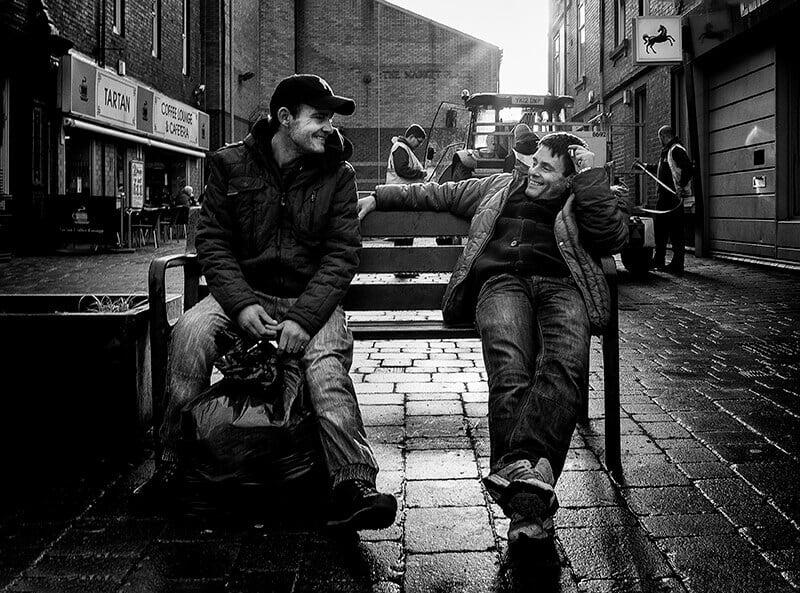 Baxcklit photo of men on bench, Castleford