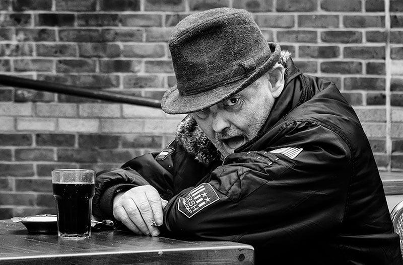 Man smoking and drinking, cafe