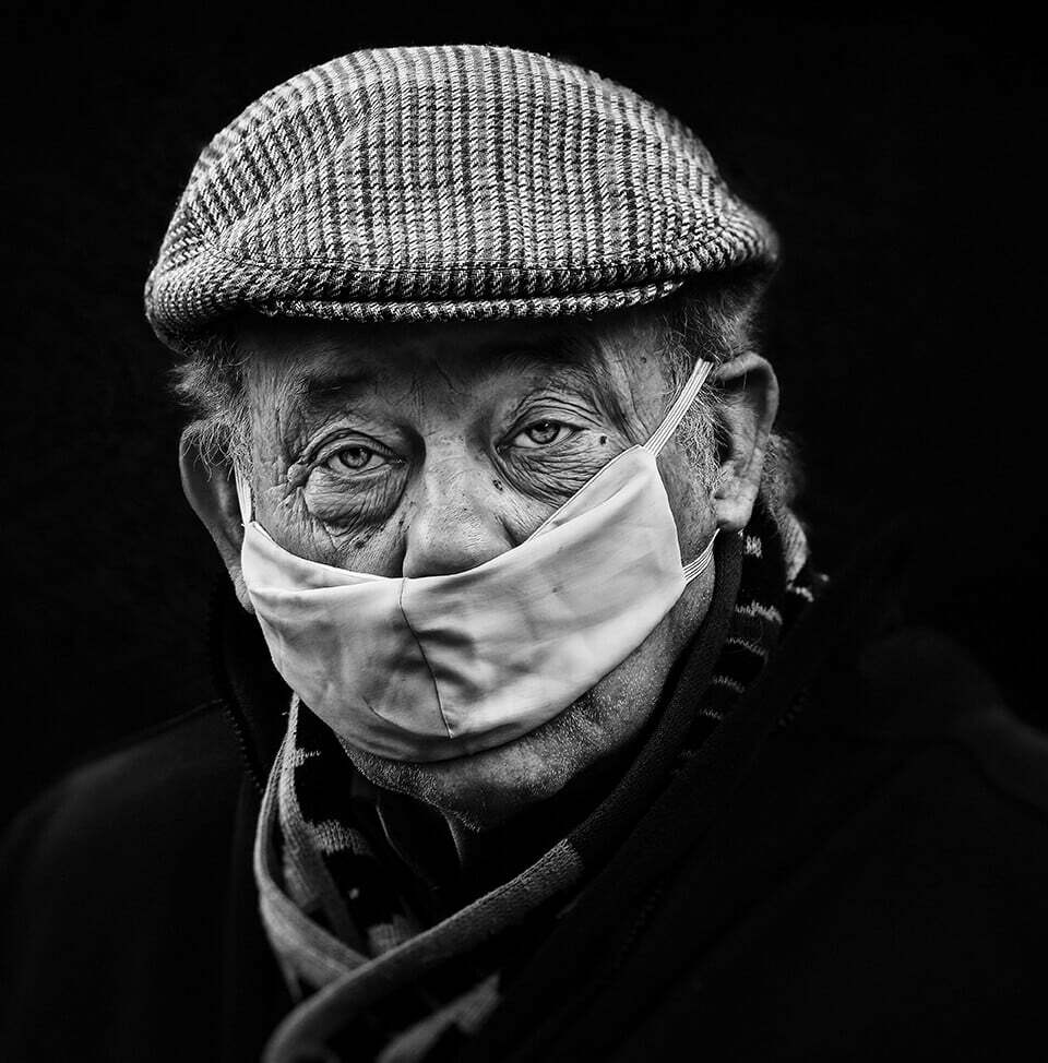 Man in Covid19 mask with black background, Castleford