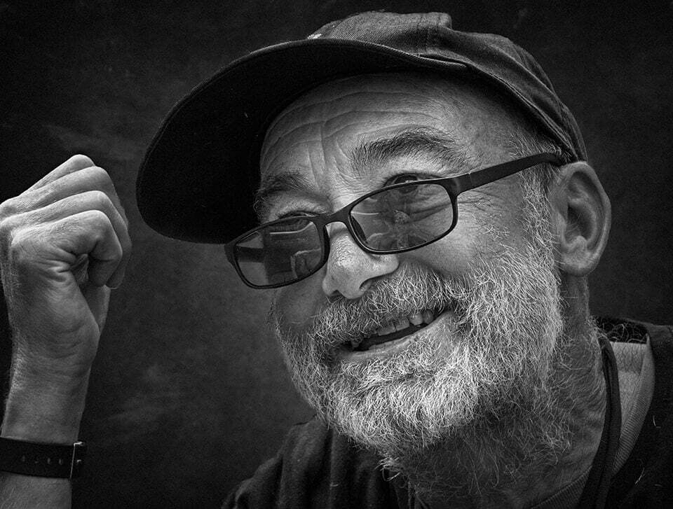 Smiling man with beard and glasses
