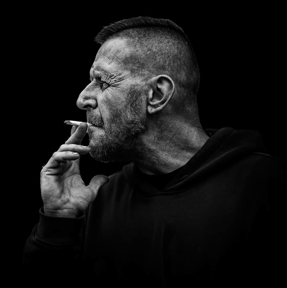 profile portrait of man smoking