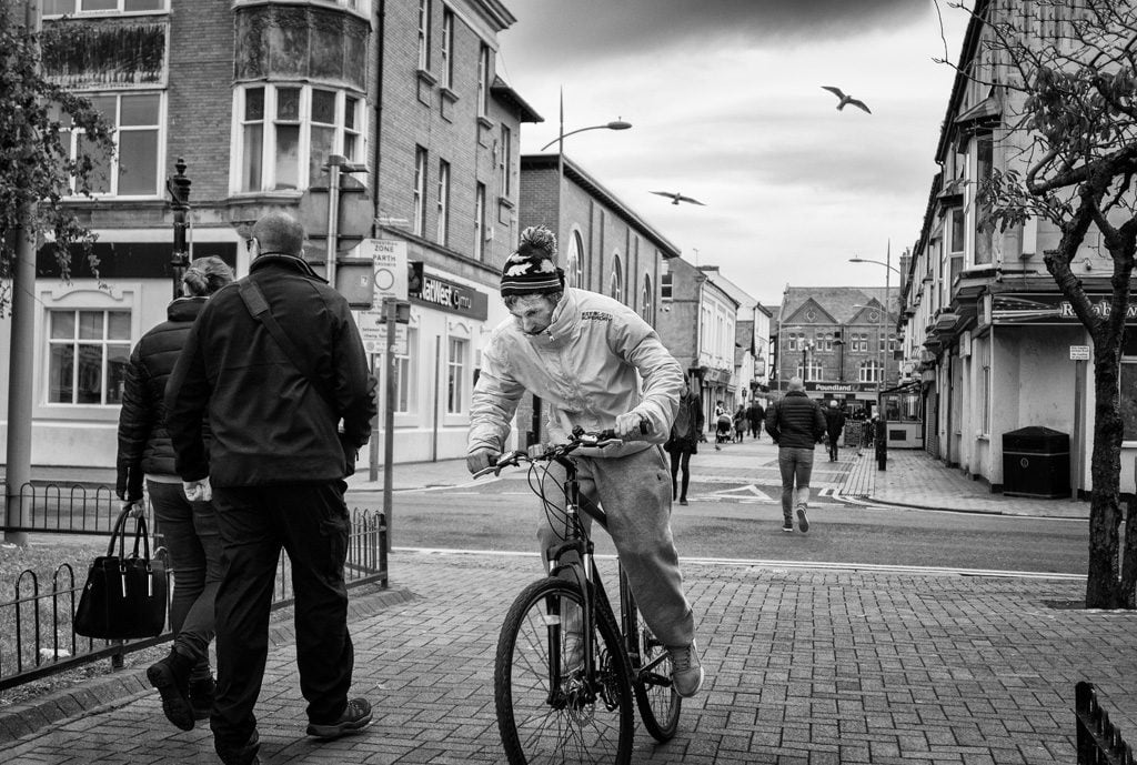Man on bike Rhyl town centre
