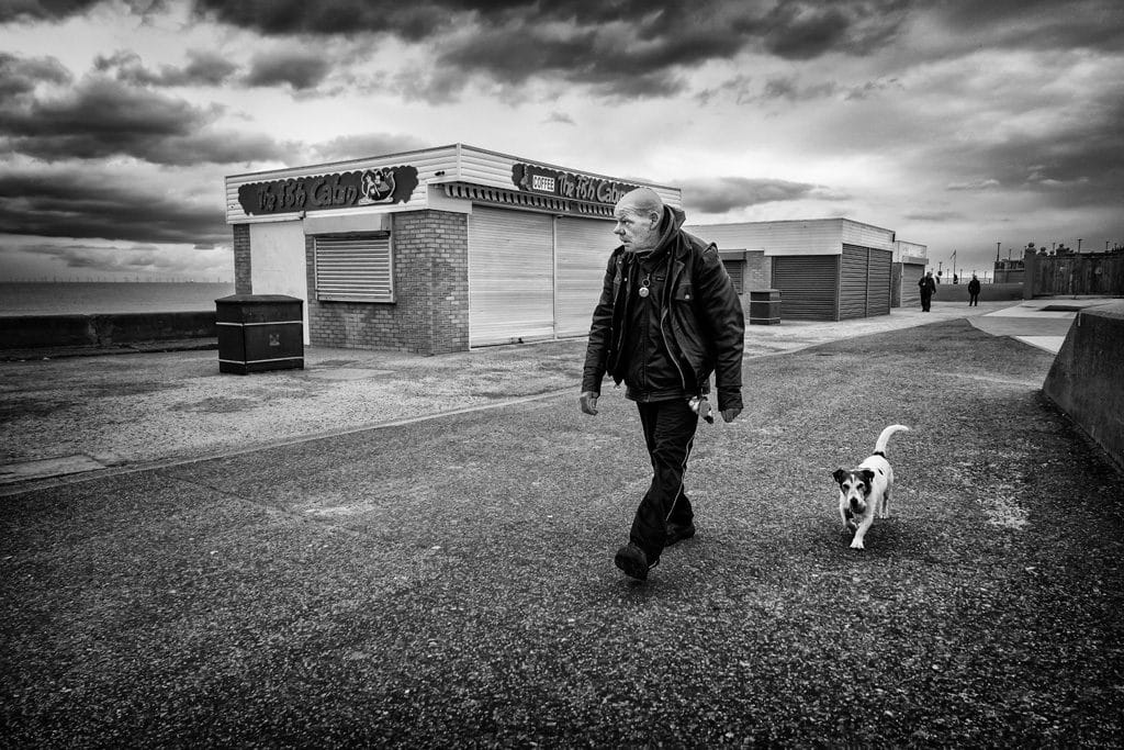 Man and Jack Russell Rhyl seafront