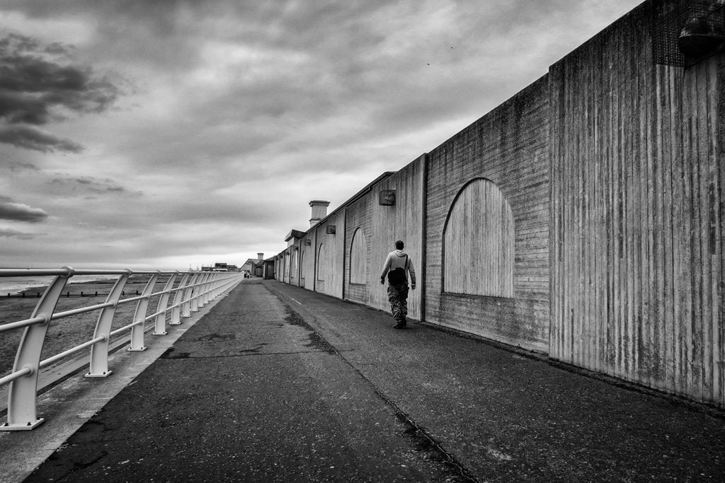 Lone man walking Rhyl seafront