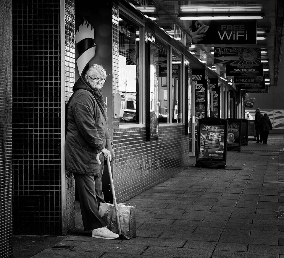 old woman outside amusements, Redcar seafront