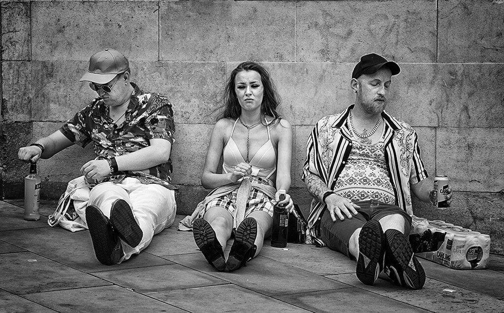 Three people sat drinking at Leeds Pride